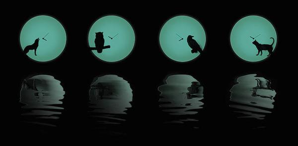 暗闇のなかを動くネコ