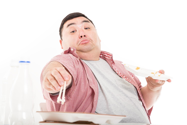 食欲旺盛な肥満な人の姿
