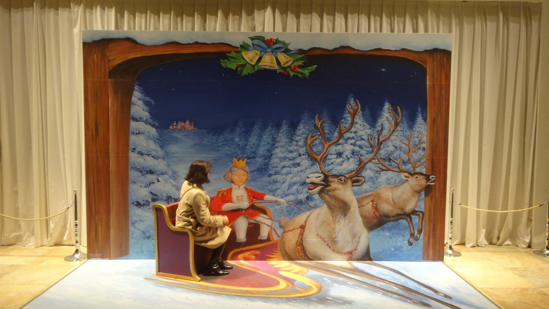 雪の森をかけぬける王子とクララのそり