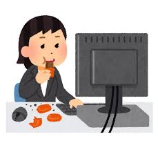 仕事しながら間食する人