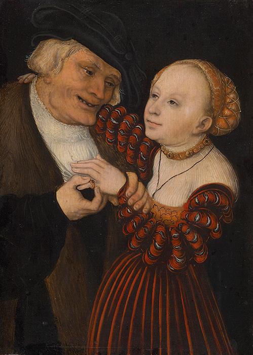 年老いた男性が 若い美しい豊満な女性を抱き寄せている様子