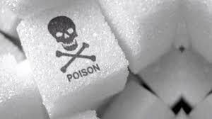 毒 と書かれた角砂糖の写真
