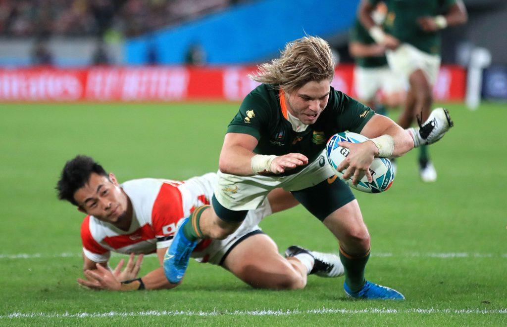 トライする南アフリカの選手