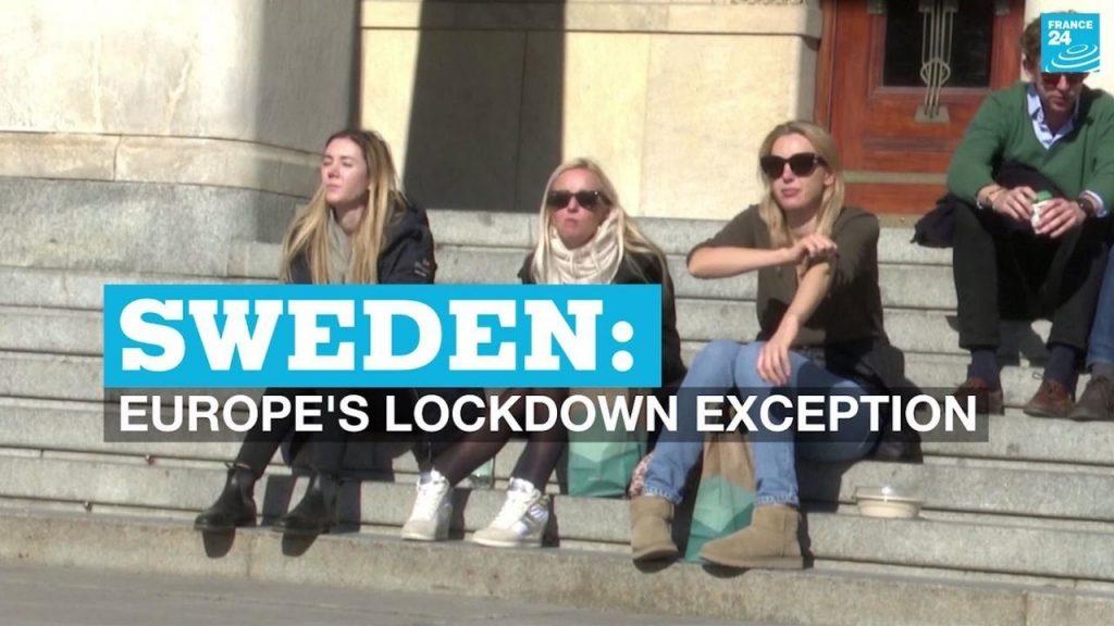 屋外で日光浴を楽しむスウェーデンの人々